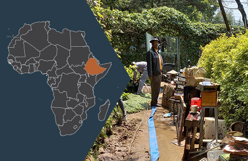 Image with map of Africa, Ethiopia highlighted, and a photo of a man standing in the aftermath of flooding.